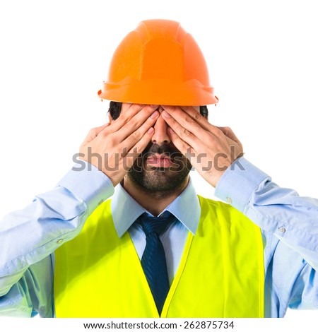 Worker covering his eyes