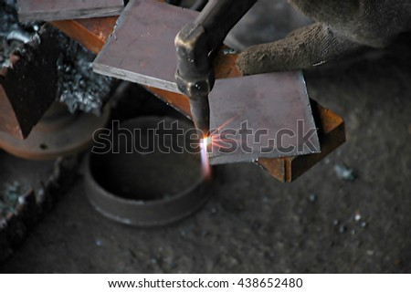 Worker cut steel with gas. - stock photo