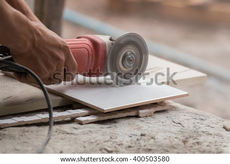 Worker Cutting Tile Using Angle Grinder Stock Photo Edit Now