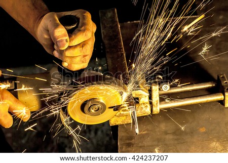 Worker cutting metal   Sparks while grinding iron