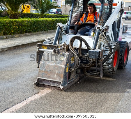 worker driver Skid steer remove Worn Asphalt during repairing Road Works