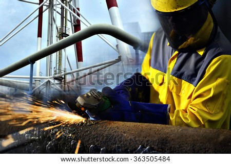 Worker during use electric wheel grinding  closeup. - stock photo