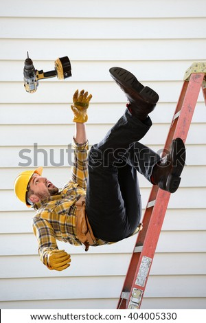 Worker falling from ladder inside room - stock photo