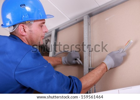 worker fixing something - stock photo