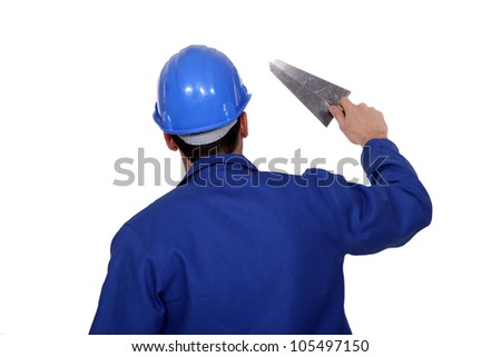 Worker holding a trowel
