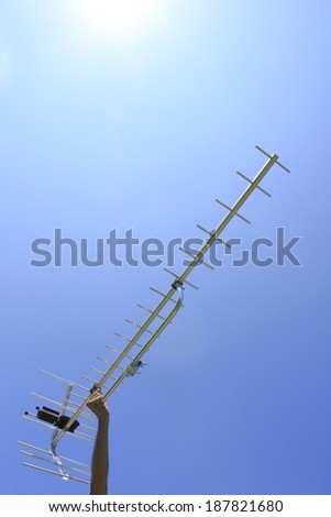 Worker holding antenna in preparation to install