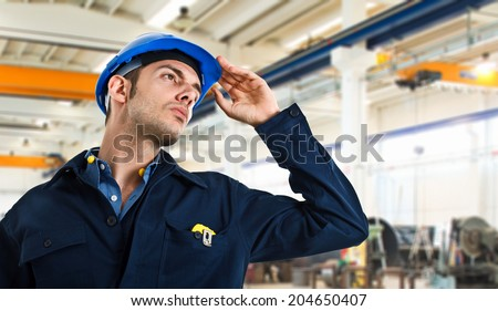 Worker holding his helmet