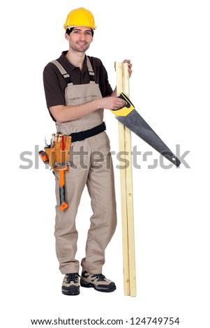 Worker holding plank of wood and hand-saw