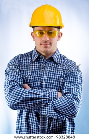 worker in a hardhat and yellow goggles - stock photo