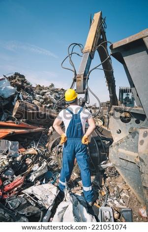 Worker in a junkyard - stock photo