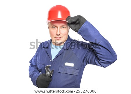 Worker in blue overall with wrench isolated over white background - stock photo