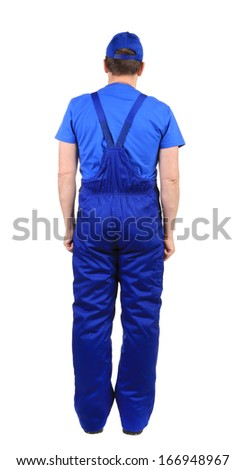 Worker in blue overalls. Back view. Isolated on a white background.