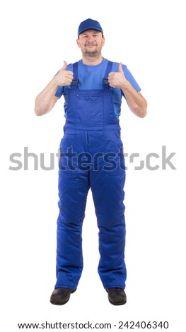 Worker in blue overalls. Isolated on a white background.  - stock photo