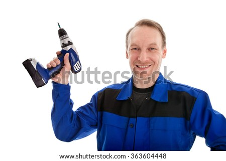 Worker in blue uniform with battery screwdriver in his hand, isolated on white - stock photo