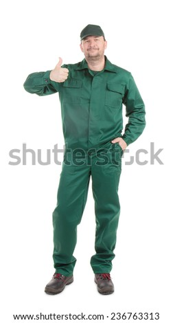 Worker in green wear with ok sign. Isolated on a white background.