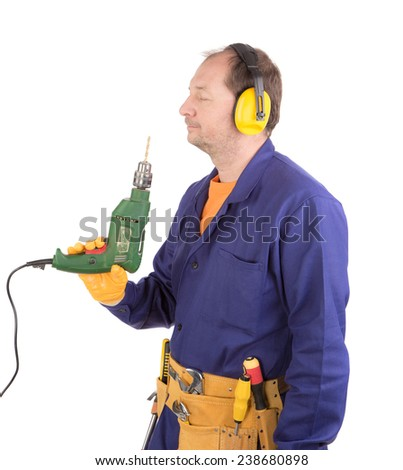 Worker in hard hat holding drill. Isolated on a white background. - stock photo
