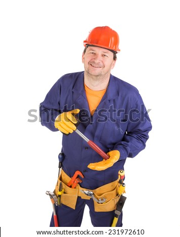 Worker in hard hat holding hammer. Isolated on a white background. - stock photo