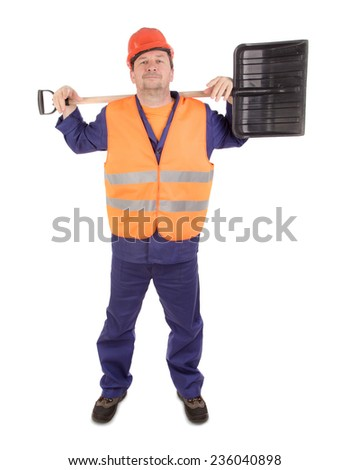Worker in hard hat holding shovel. Isolated on a white background. - stock photo