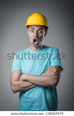 worker in helmet surprised - stock photo