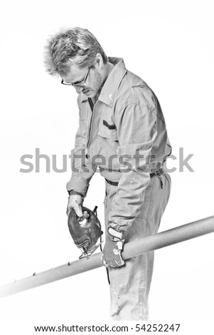 worker in overalls saws pipe with a jigsaw, isolated on white, B&W - stock photo