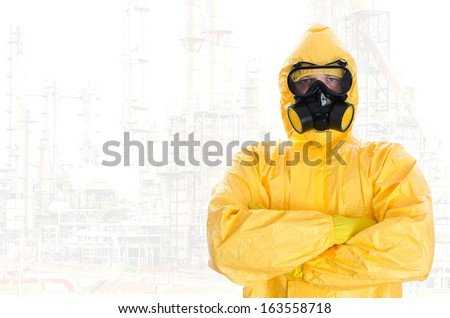 Worker in protective chemical suit. Space for your text. - stock photo