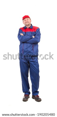 Worker in red-blue workwear. Isolated on a white background. - stock photo