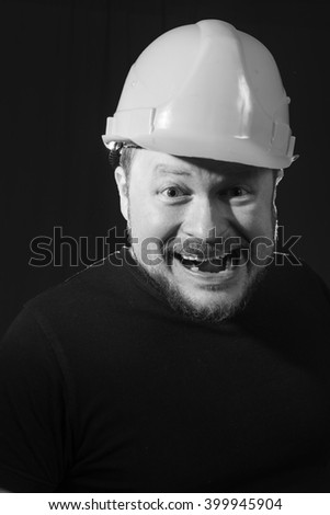 Worker in safety helmet emotional portrait