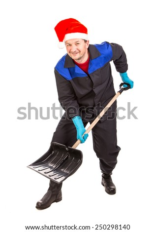 Worker in santa hat with shovel. Isolated on a white background.