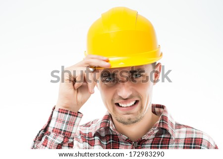 Worker in yellow helmet