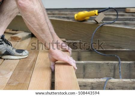 Worker Installing Cedar Deck - stock photo