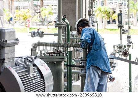 worker is cleaning filter of strainer - stock photo
