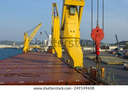 Worker loading with ship port  - stock photo