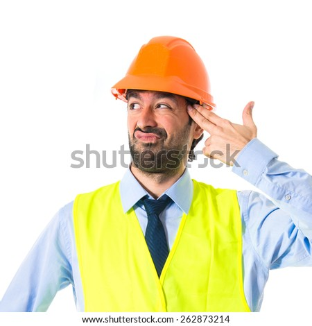 worker making suicide gesture  - stock photo