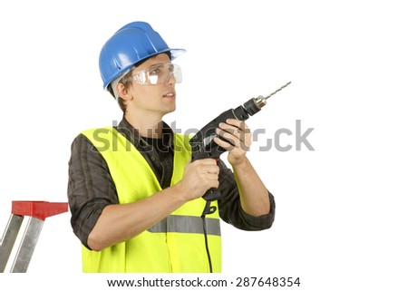 Worker man with a drill. Isolated on white.