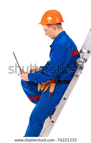 Worker man with laptop in work-wear against white - stock photo