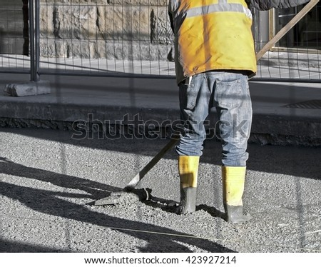 worker man with the shovel working in the sun - stock photo