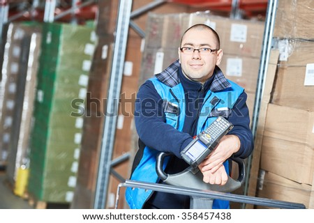 Worker man with warehouse barcode scanner - stock photo