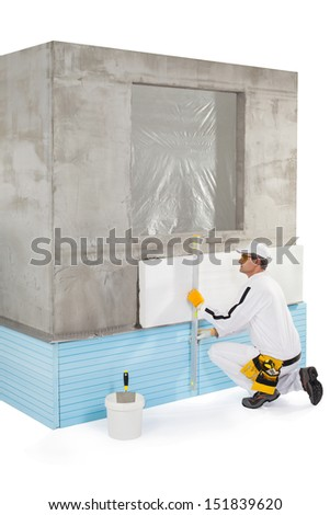 Worker measuring with a level tool - stock photo