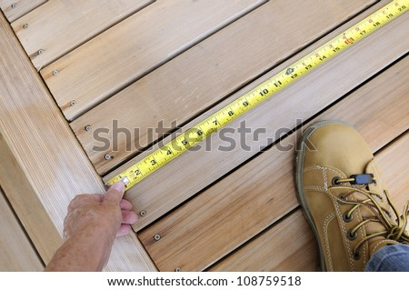 Worker Measuring Wood - stock photo