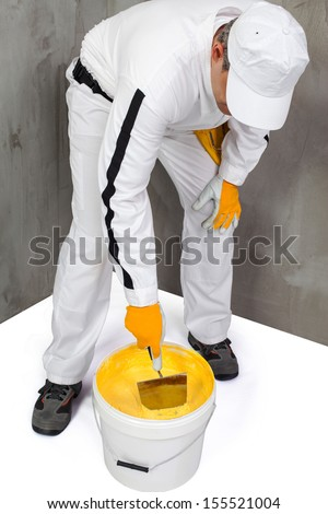 Worker mixing a plaster with a trowel - stock photo