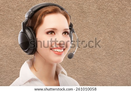 Worker of support service on connection with headphones