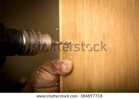Worker of the construction arming a wood closet. Do it yourself