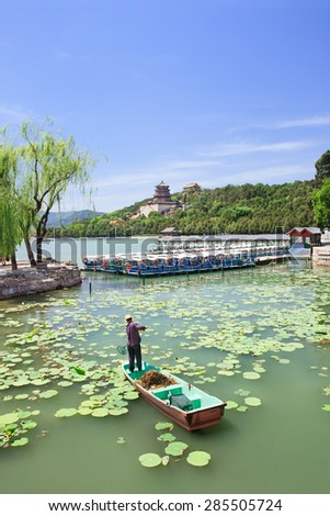 Worker on a boat in Kunming Lake, Summer Palace, Beijing, China - stock photo