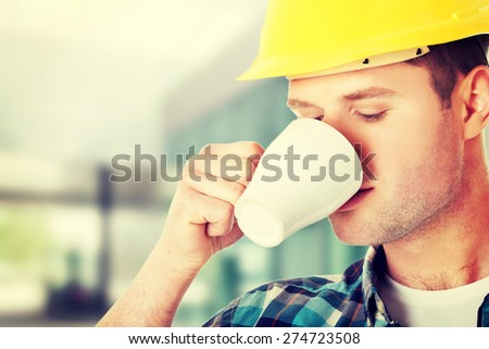Worker on a break drinking coffee and having a rest - stock photo