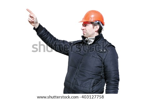 Worker on a construction site in winter directs and hand gesticulating isolated on white background
