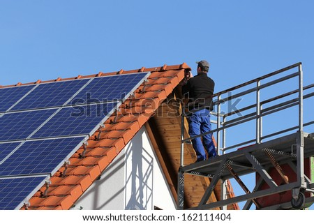 Worker on a lifting ramp - stock photo