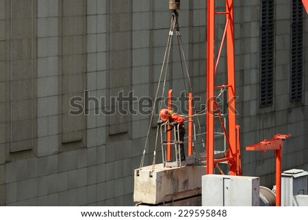 worker on construction cranes. - stock photo