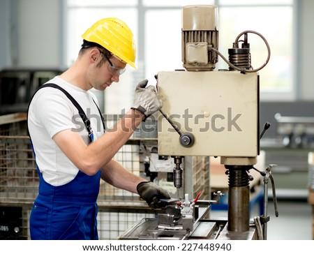worker on drill machine - stock photo