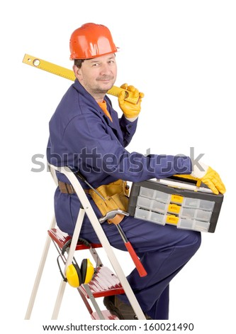 Worker on ladder with ruler and toolbox. Isolated on a white background. - stock photo