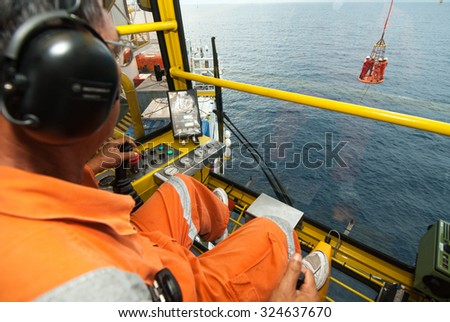 worker on offshore rig - stock photo